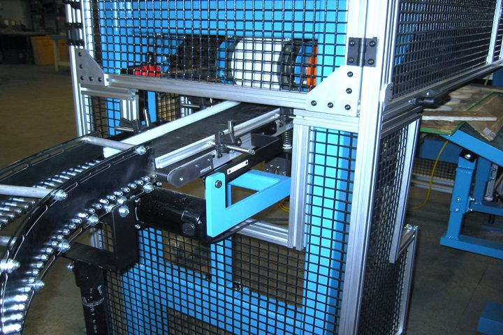 Model 366 Magnetic Furnace Unloader transfer conveyor. Note: The transfer conveyor transitions parts from the magnetic belt conveyor to a blue steel gravity conveyor in this application.