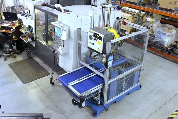 Top right hand view of the Model RMT positioned on the right hand side of a CNC vertical machining center. Note: The RMT is provided mounted on a steel skid making removal and placement at another machine tool extremely easy. The RMT may be moved with a standard pallet jack or fork truck.