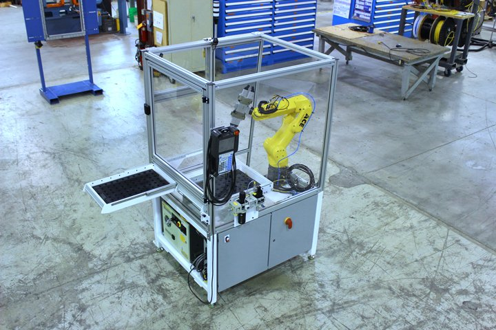 Dual drawer RoboCart with a FANUC LRMate 200iD/7L robot and dual gripper end of arm tool. The dual drawer setup allows the robot to continue working on one drawer, while an operator is loading/unloading the second drawer.