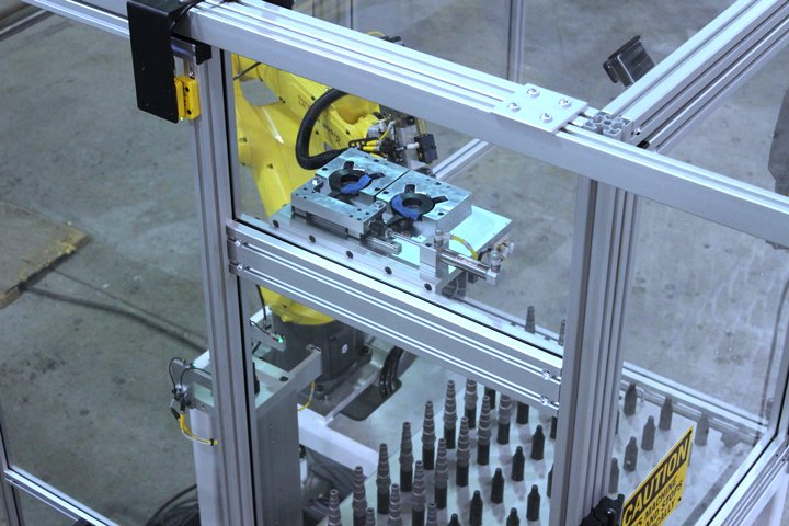 RoboCart with a Ready Tool® Grinder Dog installation and removal station. Grinder Dogs are designed to hold and turn a workpiece for cylindrical grinding or light lathe work. This option allowed the FANUC LRMate 200iD/7L robot to load/unload a grinder in addition to installing and removing the grinder dogs, which previously was a manual operation.
