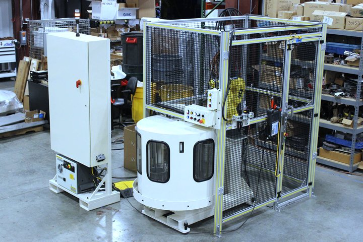 Front right corner view of the Model WS8100 Mate Machine Tender. Note: The robot is supported on an integrated base with the WS8100 Workstocker. Fork pockets are provided for ease of system relocation.