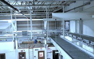 2 Raised 90 degree Hytrol EZ Logic 24-volt zero pressure accumulation conveyor