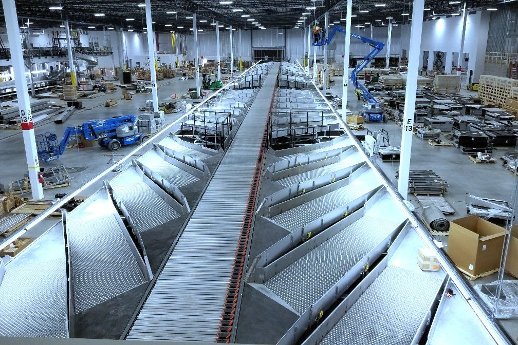 Custom engineered conveyor systems, chutes and high-speed shoe sorter for Global Parcel Shipping Company