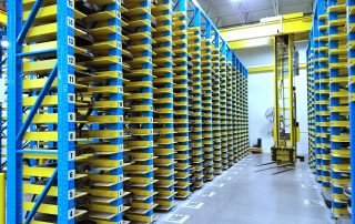 Overhead fork stacker crane sytem for automated storage and retrieval application