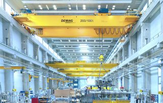 Demag heavy overhead bridge crane in a manufacturing facility