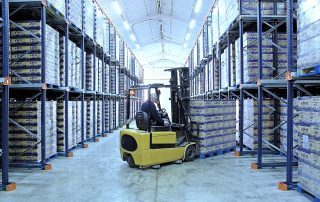 Aisle of Interlake Mecalux Drive in Pallet Rack System with fork truck operator moving product