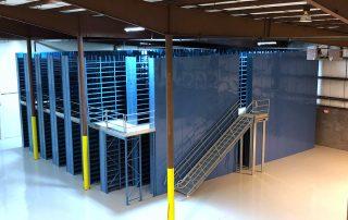 2 floor Cogan mezzanine installation in corner of manufacturing facility for parts storage.