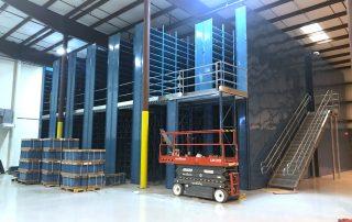 2 floor Cogan mezzanine installation with scissor lift and parts