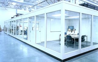 Full height windowed modular office in manufacturing facility