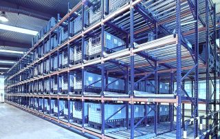 Interlake Mecalux Pallet Flow Rack with product stored in the units within a warehousing facility