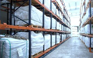 Product stored in 2 rows of Interlake Mecalux push back pallet rack.