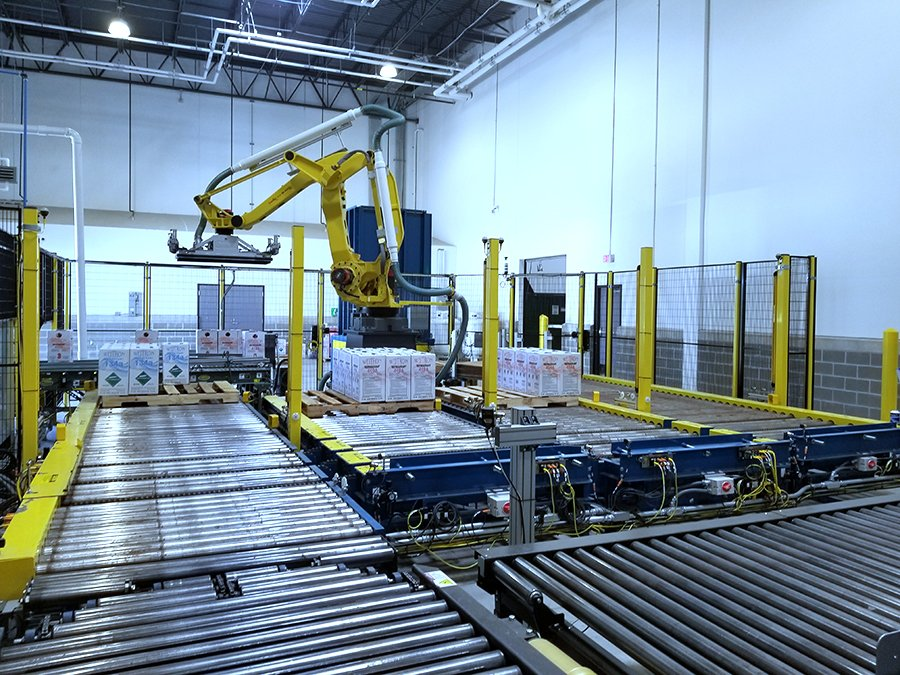FANUC M-410 case palletizing robot cell outfeeding product to 4 outfeed Hytrol pallet handling CDLR lines