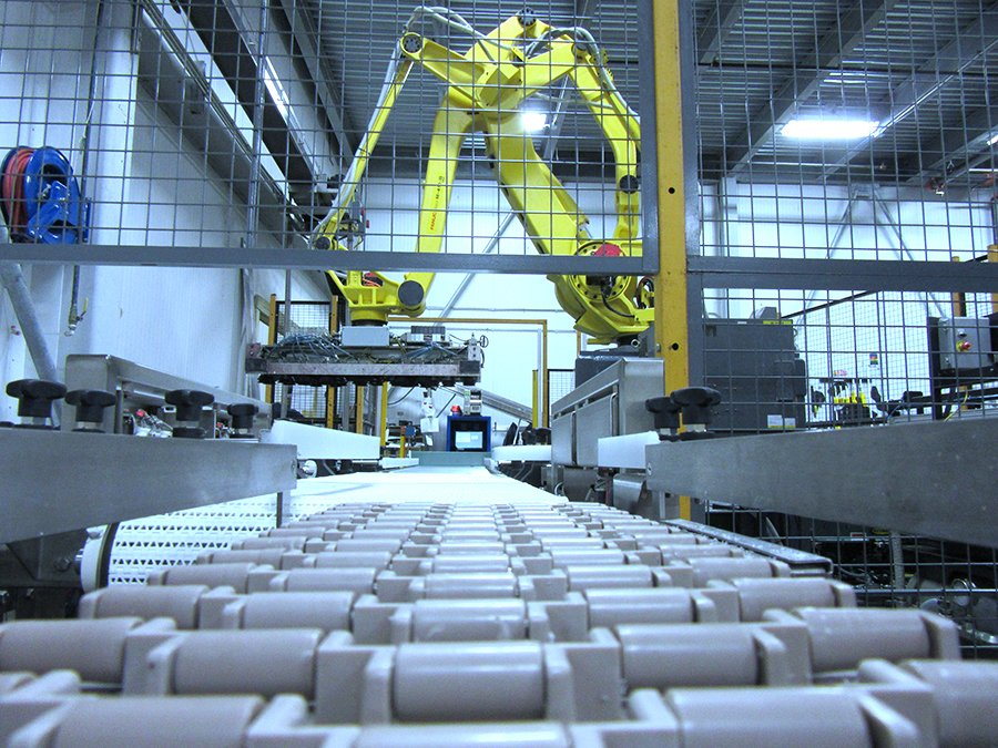 FANUC M-410 case palletizing robot using suction custom end tooling to move product from Dorner conveyor line