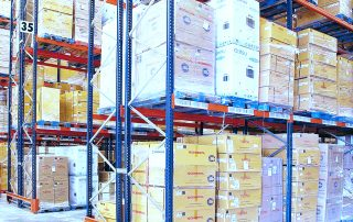Fork truck exiting row of Interlake Mecalux Select Pallet Racking in warehouse facility.