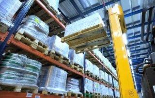 View of fork truck setting pallet load onto Interlake Mecalux Select Pallet Rack