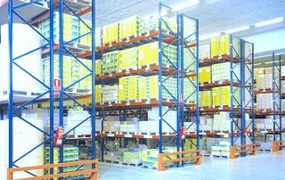 Multiple rows of Select Pallet Rack storing products in a warehouse facility.