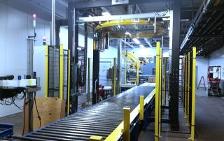 Muller Ring stretch wrapper on the pallet handling CDLR outfeed line from a FANUC robotic palletizing system
