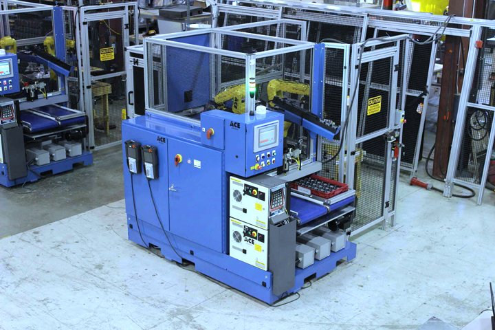 Adaptec Robotic Laser Marking Cell with FANUC robots