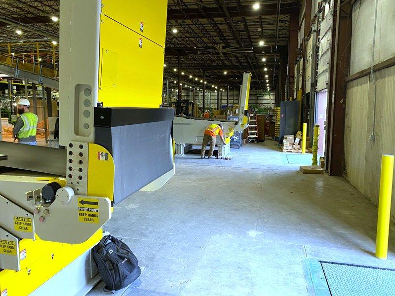 Adaptec Service Techs installing SRS Santa Rosa Systems Telescopic Conveyors