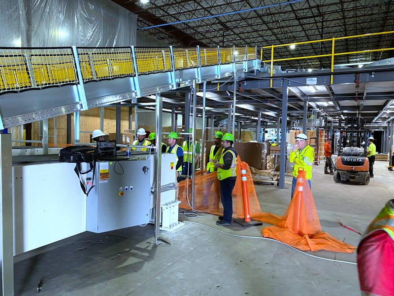 Adaptec installs SRS Santa Rosa Systems Telescopic Conveyors and controls at Global Retailer