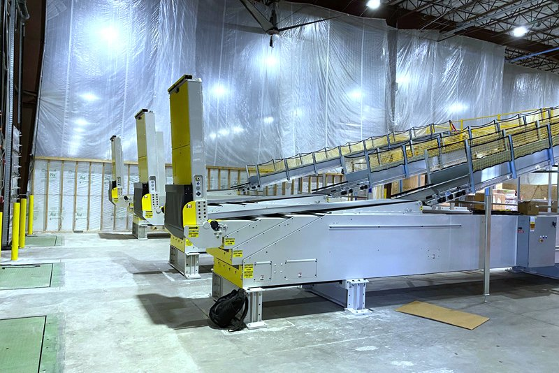 3 SRS Santa Rosa Systems Telescopic Conveyors at Global Retailer used to improve truck loading process