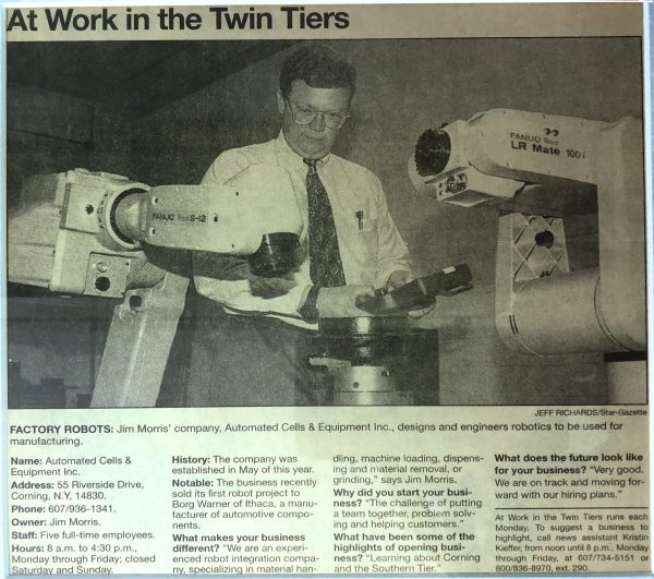 Jim Morris the founder of Automated Cells & Equipment Inc pictured in a newspaper clipping working with FANUC robots