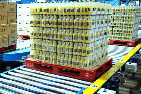 Hytrol Chain Driven Live Roller Conveyor CDLR with bottled product on pallets