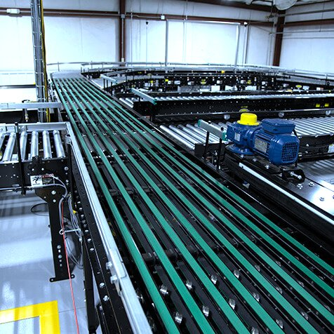 Hytrol ProSort Narrow Belt Sorter Close Up wit multiple CDLR lines for diversion