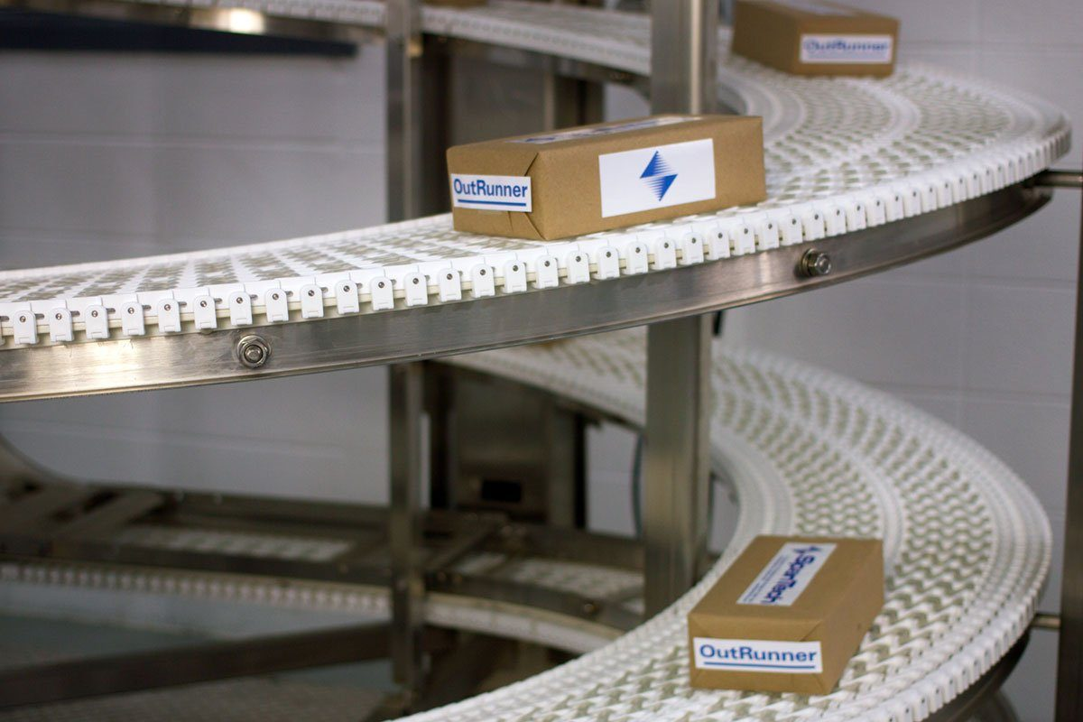 Spantech Vertical Spiral Conveyor moving boxed product down the line