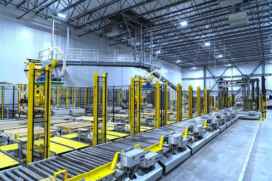 2 Fanuc robotic palletizers, Alba pallet conveyor, Wulftec stretch wrapper and Hytrol decline conveyor